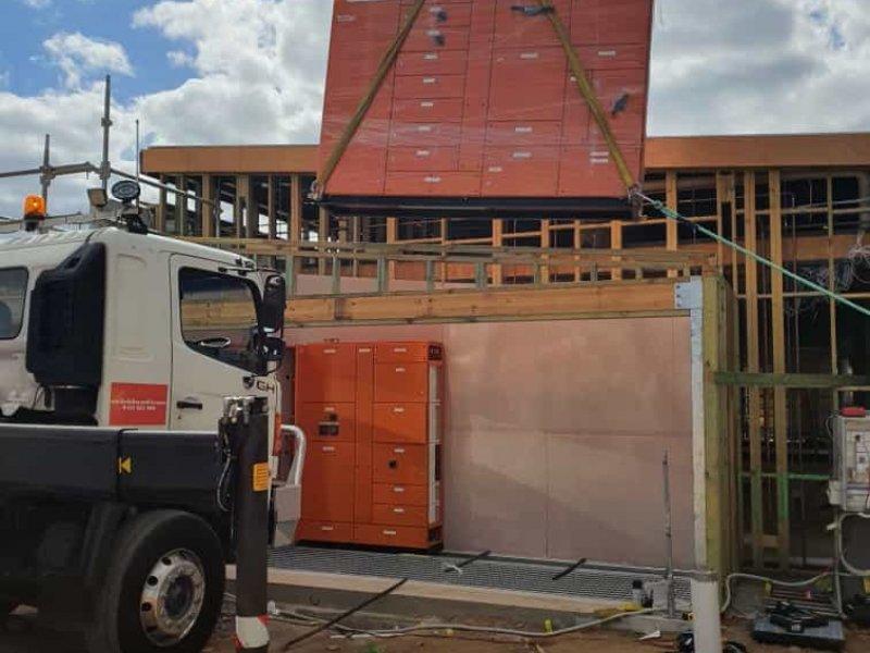 Crane lifting bricks